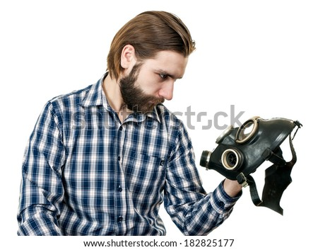 the man with beard watching at a gas mask