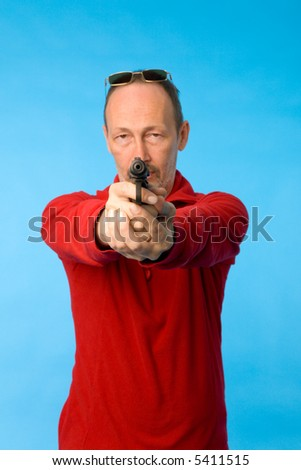 the mature man with gun on blue background