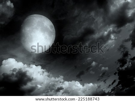 "The moon in the night sky in clouds ""Elements of this image furnished by NASA"""