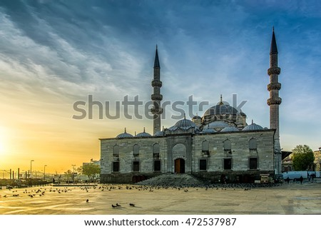 The New Mosque (Yeni Cami) at sunrise, twilight, in Eminonu district of Istanbul, Turkey.