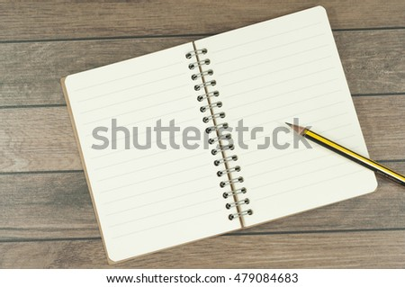 the note book on the wooden desk.