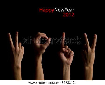 The number 2012 shown by fingers in creative New Year greeting card