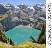 The Oeschinensee lake in Switzerland, alps - stock photo