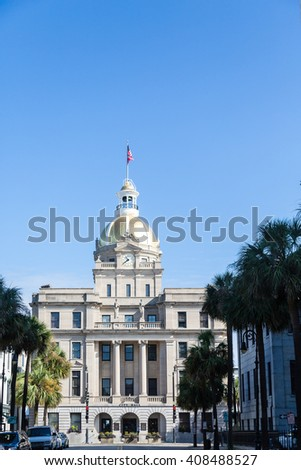 The old city hall in Savannah Georgia with American flag, gold dome and clock tower