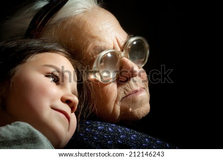 The old grandmother and her young cute grandchild