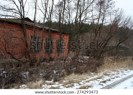 The old red brick building on the edge of the forest