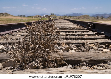 The old train tracks through the southern California desert.