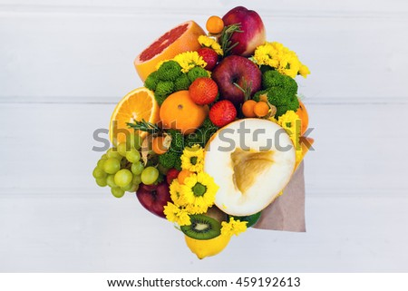 The original unusual edible bouquet of fruits on a wood