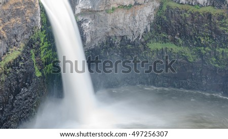 The panoramic scenic view of Palouse Falls with large bowl water at Palouse Falls State Park, a 105-acre Washington state park in the Palouse region of Eastern Washington, USA.