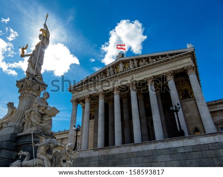 "the parliament in vienna, austria. with the statue of ""pallas athena"" of the greek goddess of wisdom."
