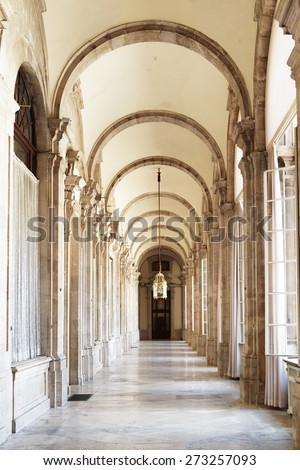 The passage with arches in the Royal Palace of Madrid in Spain. Madrid is a popular tourist destination of Europe.