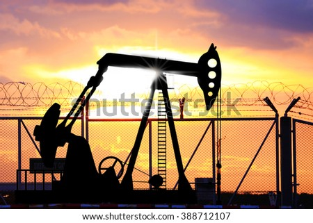 The petroleum oil pump in sunset sky