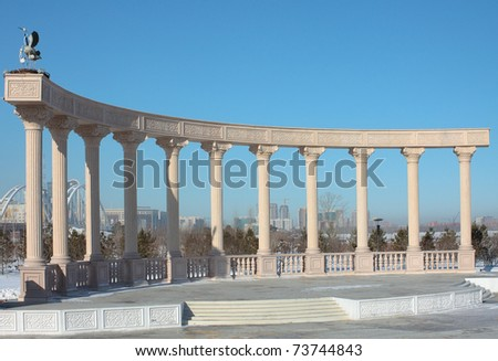 The photo Colonnade in one of parks of capital of Kazakhstan, symbolizes a family, marriage, a birth of children.