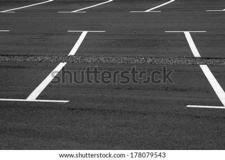 The photograph of a parking lot with parking / Parking lot