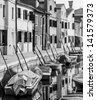 The picturesque houses on the shore of a narrow channel - Burano, Venice, Italy (black and white) - stock photo