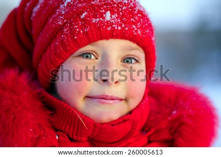 The pink-checked girl in red on a frost