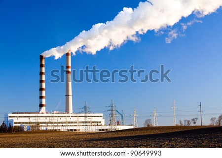 The power station located about chemical plant (winter season)
