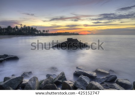 The remnants of old military fortress from world war II at Kuala Dasar Sabak Beach in Kelantan Malaysia during sunset