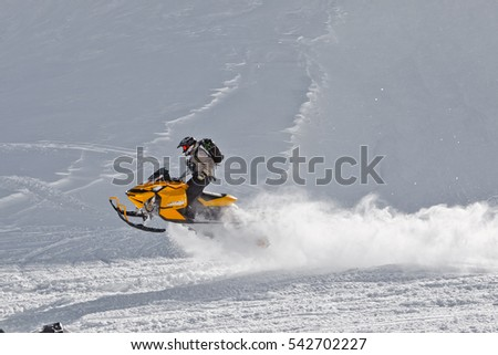 The rider bounces on a snowmobile on a plateau of Lago-Naki in Adygea, Russia February 2, 2012.