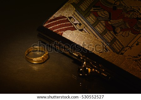 the ring with purse