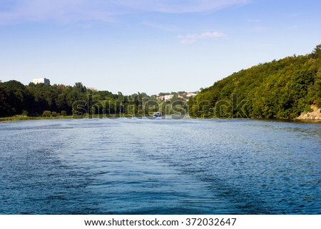 the river the Southern Bug with steamship and hills with green trees around
