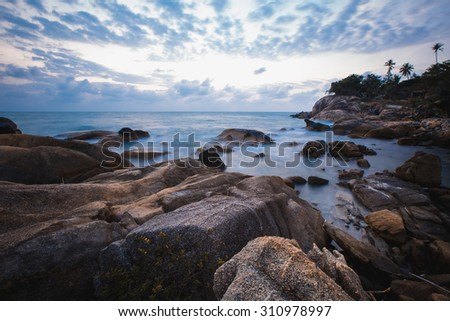 The rocky shore or beach, Andaman Sea, Thailand. Sunset