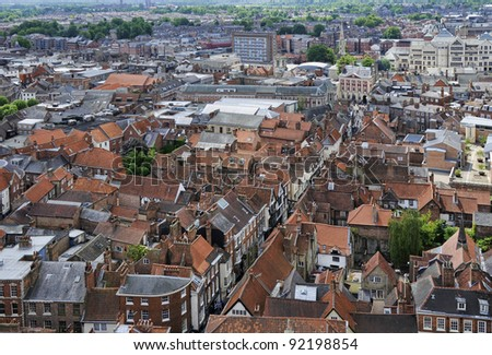 The rooftops of the city of York taken from York Minster showing lots of red tiled roofs
