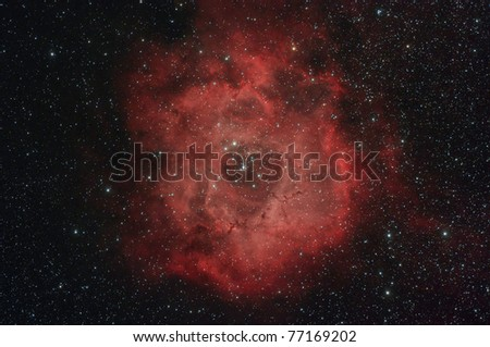 The Rosette Nebula (also known as Caldwell 49) is a large, circular H II region located near one end of a giant molecular cloud in the Monoceros region of the Milky Way