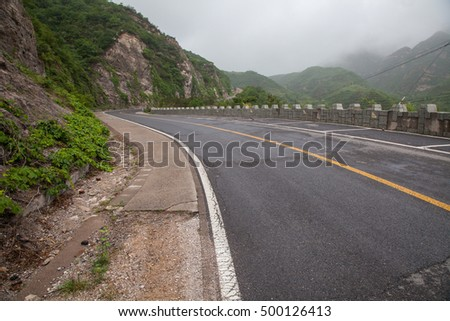The rugged mountain road is shrouded in haze in Beijing, China