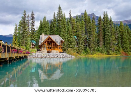 The scenic Emerald lake at Canada, Alberta. The green blue color of the lake looks amazing .