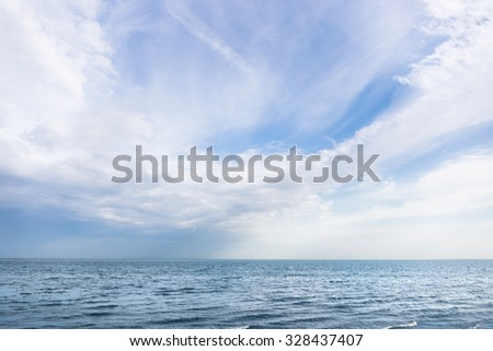 The sea and the sky with white clouds.