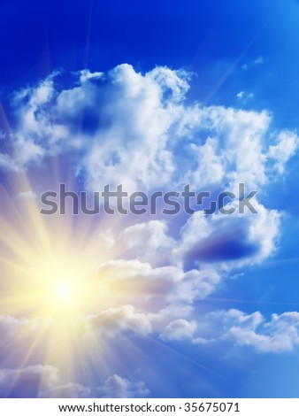 The sky dark blue with clouds and sun