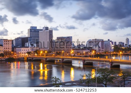 The skyline of the city of Recife in Pernambuco, Brazil at sunset showcasing its mix of historic and contemporary architecture at sunset.