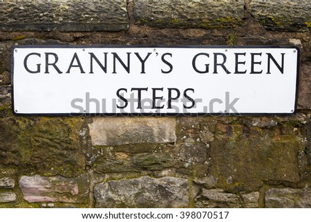 The street sign for Grannys Green Steps in the historic city of Edinburgh, Scotland.