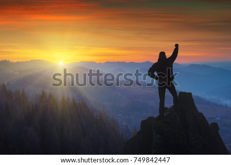 Woman Successful Hiking Climbing Silhouette Mountains Stock Photo - This man hikes up the transylvanian mountains every morning to photograph sunrise