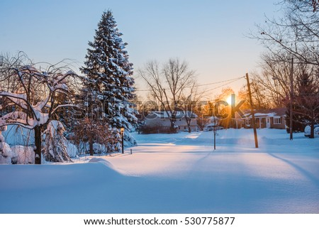 The sun rises over freshly fallen snow in this Central New Jersey neighborhood.