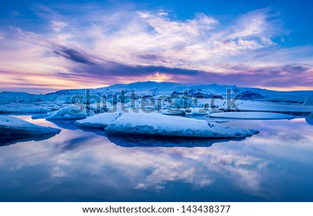 The sun sets over the famous glacier lagoon at Jokulsarlon, Iceland.