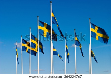 The Swedish flag flying in the wind