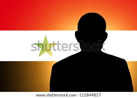 The Syria flag and the silhouette of an unknown man