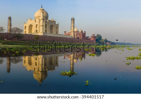 The Taj Mahal View from the boat on the opposite side of the river Yamuna, sunrise time, March 2016.
