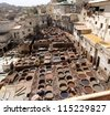 The tanneries in Fes, Morocco date back at least nine centuries. - stock photo