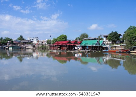 The Thai middle region style floating house along the river in Uthaithani, Thailand