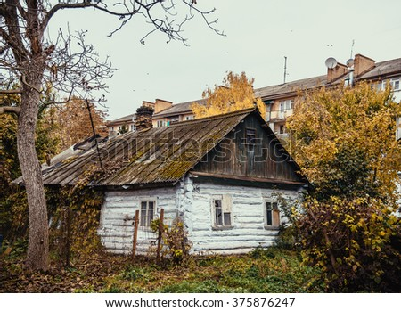 The thrown old wooden house in the city