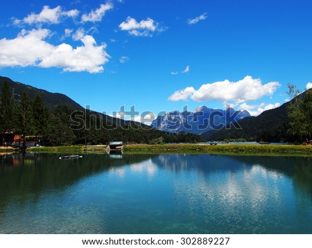 The Tudaio mountain reflection on the cristal clean water of the Center Cadore lake in the Dolomiti mountains