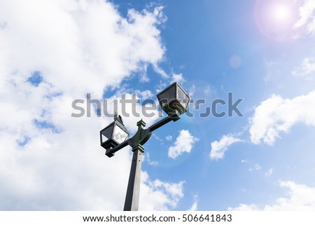 The twin lamp pole and blue sky with flare