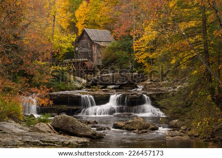 The vibrant colors of Autumn surround the old grist mill at Babcock State Park in West Virginia.