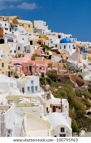 The village of Oia in Santorini Island, a typical summer destination in Greece.