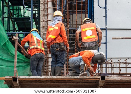 The welder, worker with protective welding metal on construction