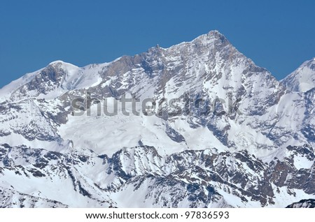 The west face of the Weisshorn in the southern swiss alps above Zermatt. To the left the Bishorn