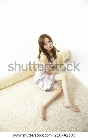 The Woman Relaxing In The Room